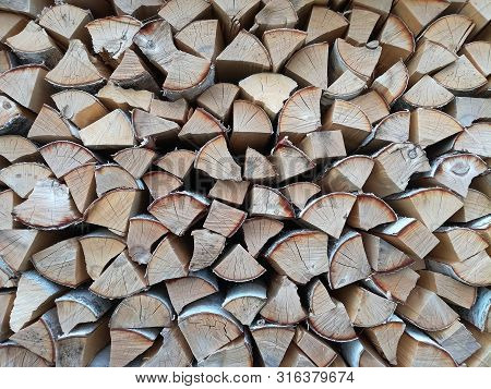 Background Of Wooden Logs. Year Rings. Pile Wood. Deforestation Theme. Wood Industry. Chopped Wood.