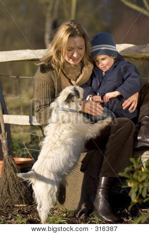 poster of a mother her young son and the family dog out in an english country garden**note : focus on the dog...