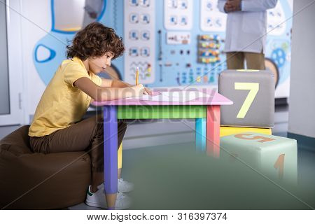 Boy Waiting For Medical Treatment Stock Photo
