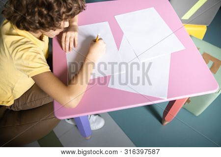 Curly Boy Drawing In Hospital Playroom Stock Photo