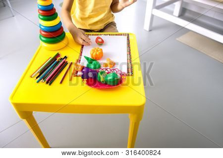 Child Is Relaxing In Hospital Games Room Stock Photo