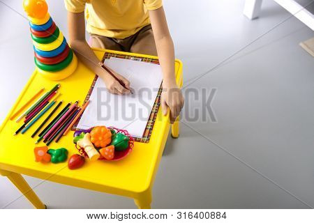 Kid Drawing In Hospital Before Examination Stock Photo