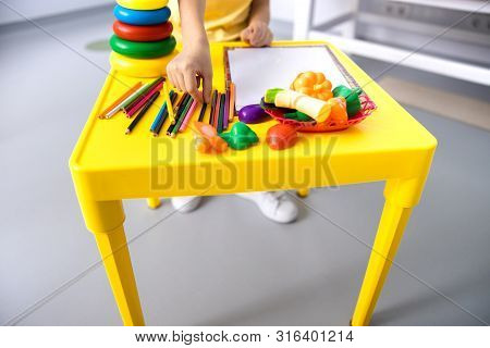 Child In Hospital Games Room Stock Photo