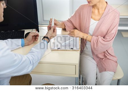 Therapist Giving Medicine To Woman Stock Photo