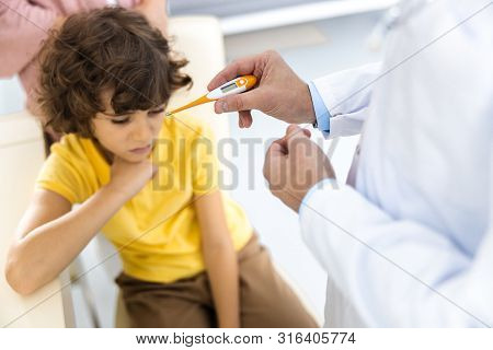 Boy With High Temperature In Hospital Stock Photo