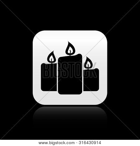 Black Burning Candles Icon Isolated On Black Background. Old Fashioned Lit Candles. Cylindrical Arom