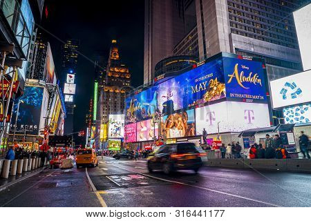 New York City, Usa - June 20, 2019: Cars, Traffic And People Crowd Rushing At Times Square At Night.