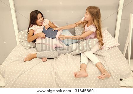 Sisters Relations Issues. Share Book With Friend. Children In Bedroom Want Read Evening Fairy Tale.