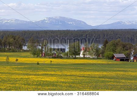 Great-lake Area, Sweden On June 04. View Of A Farm This Side The Mountains On June 04, 2019 In Great