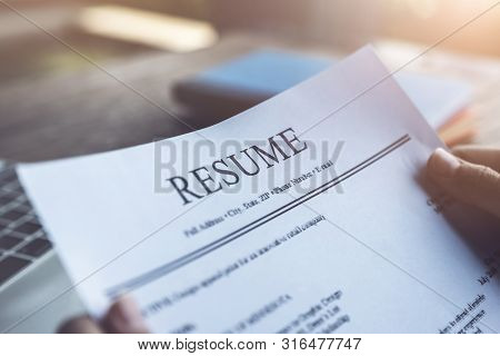 New Graduate Student Holding Resume Application With Pen Coffee Cup Keyboard And Notebook For Applyi