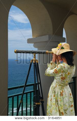 Girl With Telescope Under Arches