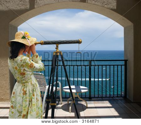 Girl With Telescope Under Arch