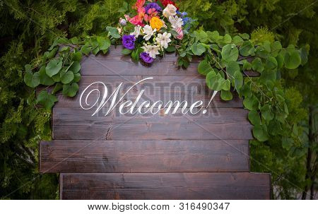 Handmade Wooden Board With Welcome Sign On It Decorated.