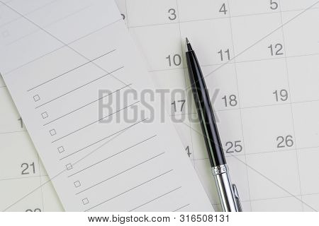 Pen On Checklist With Checkbox Notepad On Clean Calendar Using As Special Event, Planner, Important