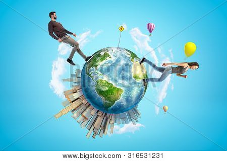 Young Man And Woman In Casual Clothes Walking On Small Planet Earth With Modern City Popping Up On O