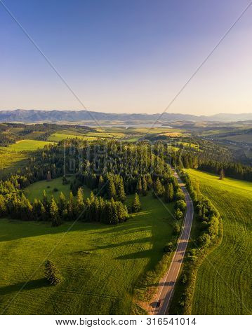 Aerial View Of A Road Going Through Forests And Villages Of The Liptov Region In Slovakia With Weste