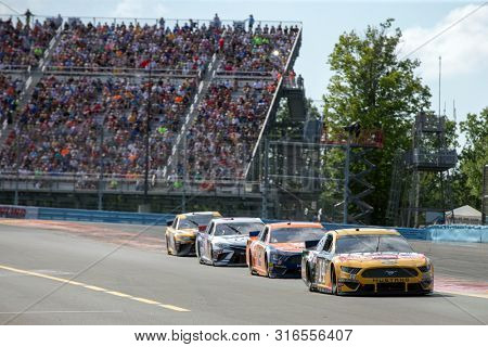August 04, 2019 - Watkins Glen , New York, USA: Clint Bowyer (14) battles for position for the Go Bowling at The Glen at Watkins Glen International in Watkins Glen , New York.