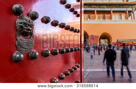 Beijing, China - December 30 2017: Ornate Doorway With Lion In The Forbidden City Looking Towards Sh