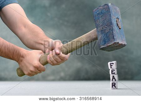 Destruction Of Fears Concept With Letters And Big Hammer.