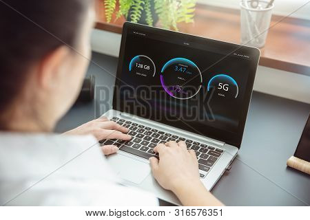 Woman Checks Wireless Connection Of 5g Technology On Her Laptop. Interface On The Screen Was Created