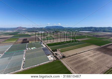 Aerial view of farm fields and the Santa Monica Mountains near Camarillo in Ventura County, California.