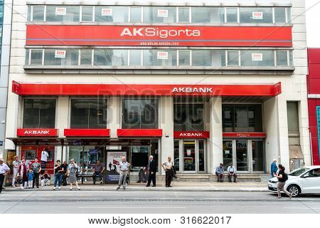 Istanbul, Turkey - 19 May 2019: Akbank Istanbul Branch With Local People And Bus Stop In Front Of Th