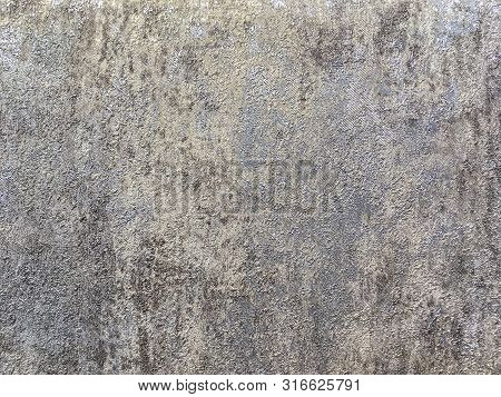 Structure Of Silver Abstract Background In The Form Of A Rough Patchy Plaster Of Gray Brown Color. T