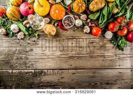 Autumn Food Concept. Healthy Organic Harvest Vegetables And Ingredients Pumpkin, Greens, Tomatoes, C
