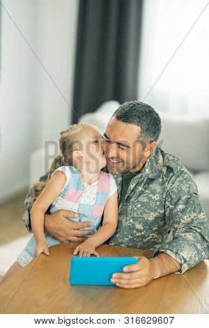 Father And Daughter Reuniting And Watching Cartoons Together