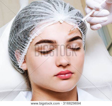 The Doctor Cosmetologist Beautician Makes The Rejuvenating Facial Injections Procedure For Tightenin