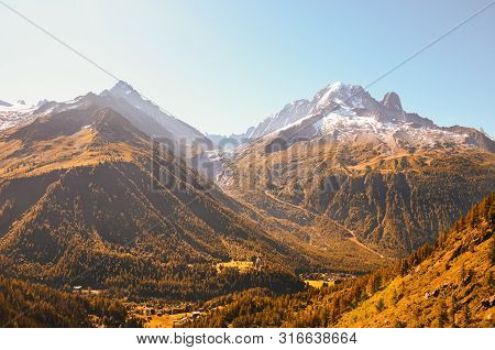Beautiful Sunset Over The Mountains In French Alps Near Chamonix. Snow Capped Mountains In Backgroun