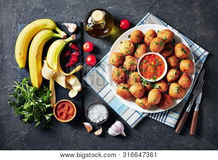 Overhead View Of Banana Croquettes Klako On A White Plate With Sauce, Party One-bite Food, African C