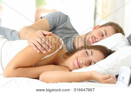 Happy Couple Sleeping Together In A Comfortable Bed In The Morning At Home Or Hotel Room