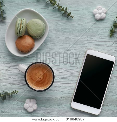 Springtime Flat Lay With Coffee, Macarons, Pearl Hyacinth Flowers, Eucalyptus, Mobile Phone And Gift
