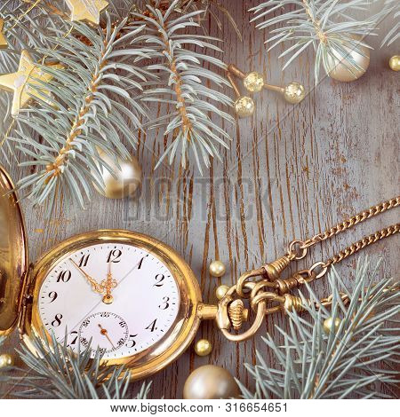 Vintage Pocket Watch Showing Five To Twelve On Gray Rustic Background With Christmas Twigs And Golde
