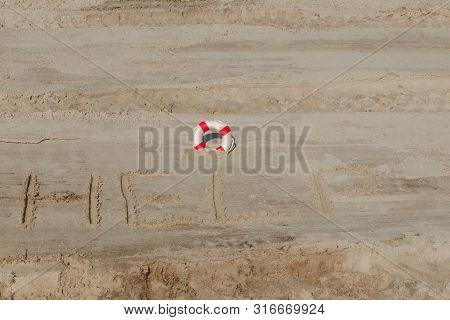 Help Me The Inscription And Lifebuoy On The Sand. Please Help Me. On A Tropical Beach