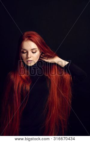 Sexy Beautiful Redhead Girl With Long Hair. Perfect Woman Portrait On Black Background. Gorgeous Hai