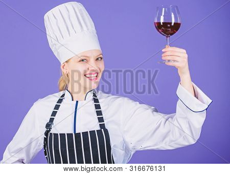 Excellent Taste. Sommelier Skills. Serving Wine At Restaurant. Woman Chef Hold Glass Of Wine. Outsta