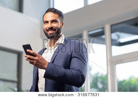 Portrait Of Handsome Man That Holding His Telephone