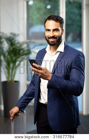 Successful Office Worker Looking Straight At Camera