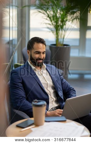 Handsome Brunette Male Person Having Video Conference