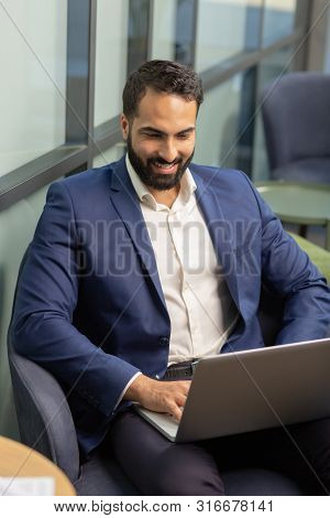 Handsome Young Businessman Working On Distance With Pleasure