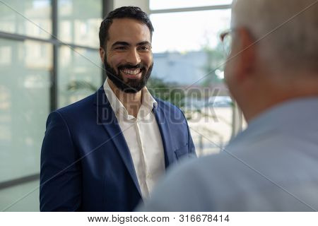 Positive Delighted Brunette Male Looking At His Employer