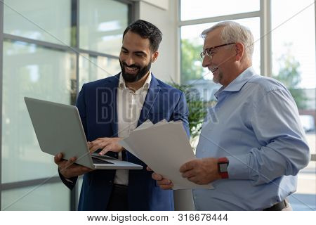 Attentive Mature Man Listening To Project Presentation