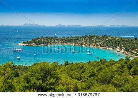 Panoramic View On Kosirina Beach Lagoon On Murter Island In Croatia, Anchored Sailing Boats And Yach