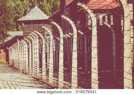Auschwitz-birkenau, Poland - August 12, 2019: Holocaust Memorial Museum. Separation Barbed Wire In P