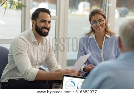 Joyful Bearded Male Person Presenting His Business Project