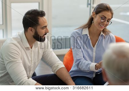 Charming Young Female Presenting Her Business Idea