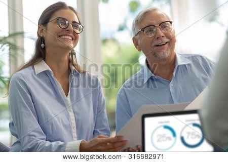 Joyful Young Woman Laughing During Business Meeting
