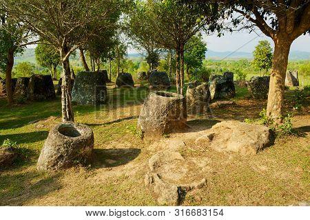 Ancient Stone Jars In A Plain Of Jars (site #3) Near Phonsavan,  Xienghouang Province, Laos.